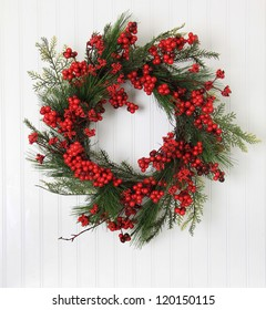 Christmas wreath of berries and evergreen.
