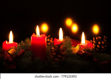 Christmas wreath with burning red candles, advent time