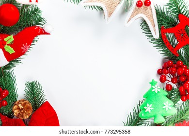 Christmas wreath with decorations, branch of Xmas tree on white background. A symbol of winter and new year holidays. Free space