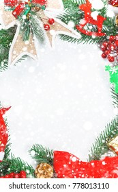 Christmas wreath with decorations, branch of Xmas tree on white background and snow. A symbol of winter and new year holidays. Free space