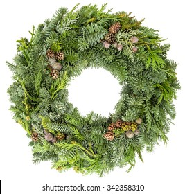 Christmas wreath from fir, pine and spruce twigs with cones isolated on white background. Festive decoration