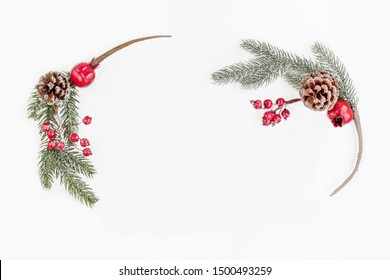 Christmas wreath with fir tree  branches and red berries.   Christmas wallpaper. Flat lay, top view. Copy space