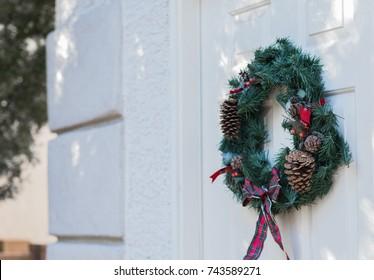 Christmas wreath hanging on door 1 -