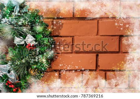 christmas wreath hanging on painted brick wall horizontal around the perimeter of the decorations