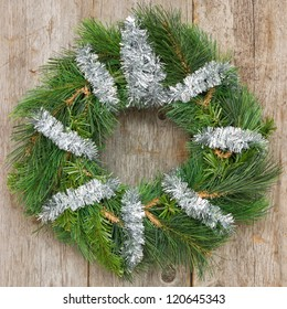 Christmas wreath hung on the wooden wall