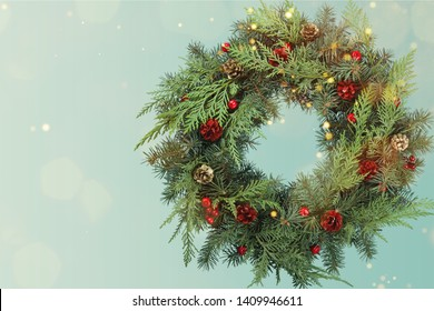 Christmas wreath made of fir tree and cones on pastel background, Christmas decorations concept