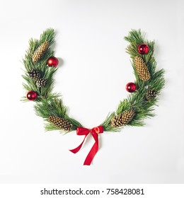 Christmas Wreath made of pine branches and xmas decoration. Merry Christmas and Happy New Year Background. Flat Lay.