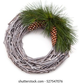 Christmas wreath made from wooden sticks, evergreen fir and pine cones