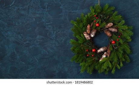 Christmas wreath on blue wall background
