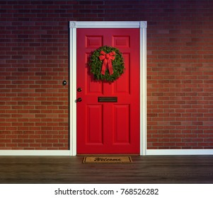 Christmas wreath on bright red front door with welcome mat.