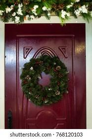 Christmas wreath on the door. Christmas home decorations.