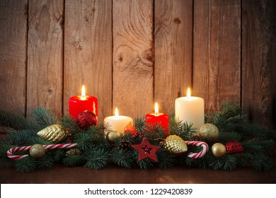 Christmas wreath on old dark wooden background