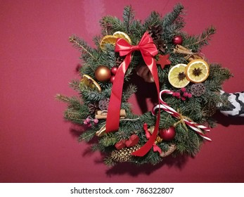 Christmas Wreath On A Red Background