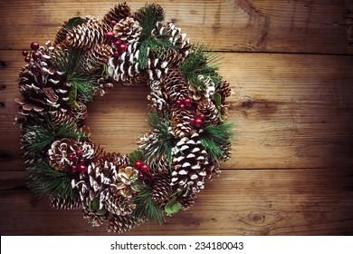 Christmas wreath on a rustic wooden front door