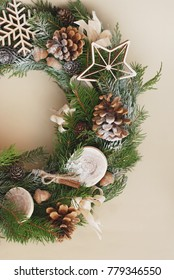 Christmas wreath on rustic wooden background. Christmas decoration with natural elemnts. Vertical Image.