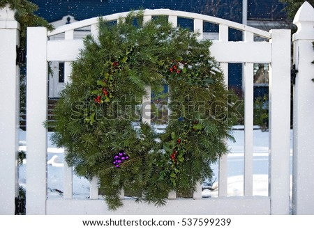 Christmas Wreath On White Fence Gate Stock Photo Edit Now