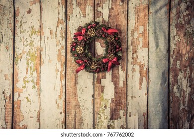 christmas wreath on wood background .