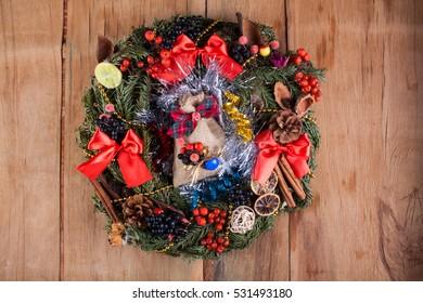 Christmas wreath on wood board. Christmas decoration. Home decoration