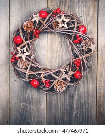 Christmas wreath on wooden background - Top view