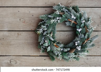 christmas wreath on wooden background. Christmas decor self made