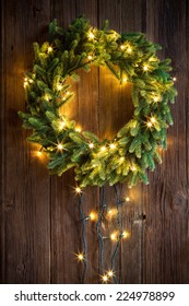 Christmas wreath on a wooden door