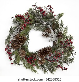 Christmas wreath from pine branches with berries and slices of ice