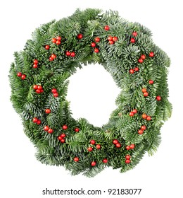 Christmas wreath pine and holly berry isolated on white background