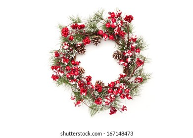 christmas wreath with poinsettia flowers and golden decoration isolated on white background