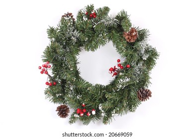 Christmas wreath with red berries and cones