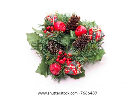 3a718770d56e A Christmas wreath with red small apples and a pine cone isolated on white  background.
