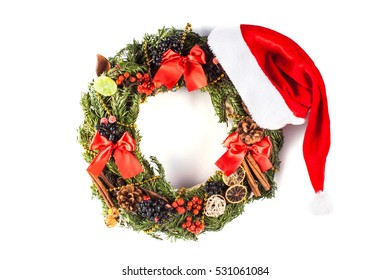 Christmas wreath with Santa hat isolated on white background. Christmas decoration