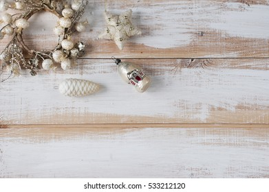 Christmas wreath, star, pine cone, house toys on wooden boards. Flat lay