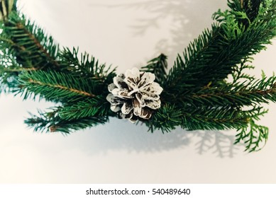 christmas wreath with white pinecone. green fir branch. decorating christmas handmade nordich wreath. home preparation. rustic concept