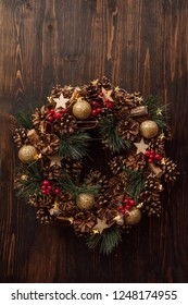 Christmas wreath at wooden background, festive wall decor