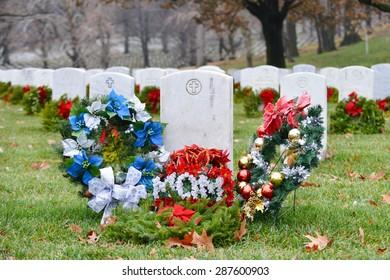 Christmas wreathes rounding a mom soldier's gravestone - Arlington National Cemetery - Washington DC