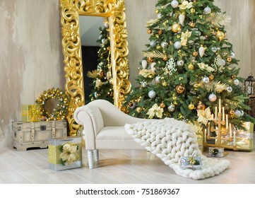 Christmas xmas casual gold studio decorations with cute girl and huge mirror with golden frame plenty presents and big green pine tree.