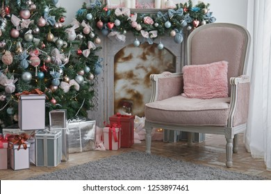 Christmas, xmas, New Year interior with pink and turquoise fur-tree decoration with balls and bowknots, ribbons, gift boxes, fireplace and armchair