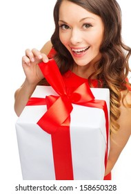 christmas, x-mas, valentine's day, celebration concept - smiling woman in red dress with gift box
