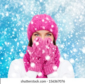 christmas, x-mas, winter, happiness concept - surprised woman in hat, muffler and mittens