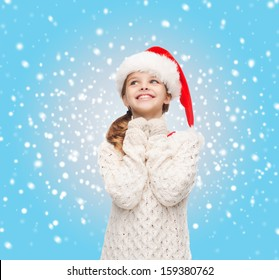 christmas, x-mas, winter, happiness concept - dreaming girl in santa helper hat