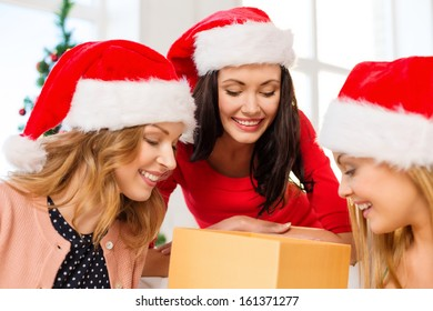 christmas, x-mas, winter, happiness concept - three smiling women in santa helper hats with many gift boxes