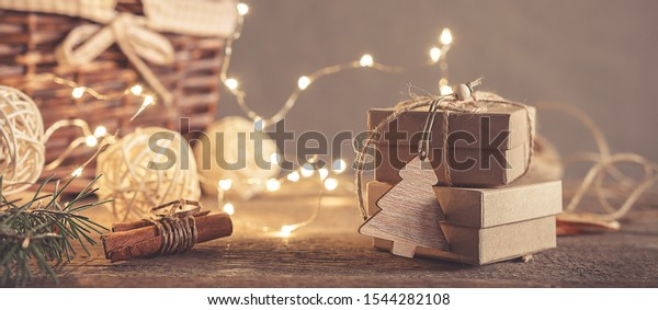 Christmas and zero waste, eco friendly packaging gifts in kraft paper on a wooden table, eco christmas holiday concept, eco decor banner