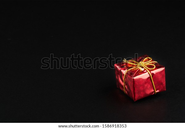 Christmass  tmass gift in red paper isolated at black background