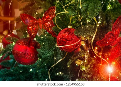 Christmass Tree decorated by Green leaf with Red ball Background
