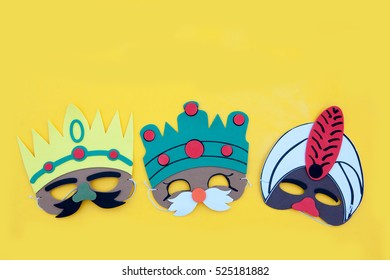 Christmas,the three kings of orient.The three wise men mask in yellow background