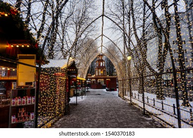 Christmas/winter market in Oslo, Norway.  Market stalls in the fairy light tunnel.  Traditional Christmas market held annually in the center of Oslo.