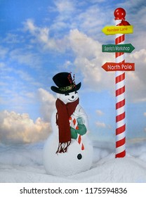 A Christmasy snowman by an outdoor pole showing the way to Santa.