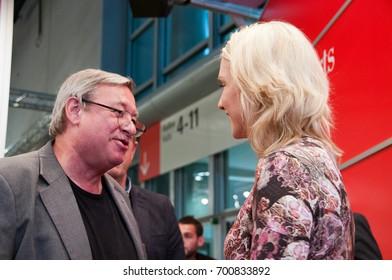Christoph Biemann (Die Sendung mit der Maus) meeting Manuela Schwesig, german politician (SPD), at the Frankfurt Bookfair / Buchmesse Frankfurt 2014 in Frankfurt am Main, Germany
