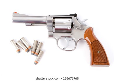 A chrome .38 police special revolver handgun with six hollow point bullets on a white background.