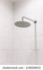 Chrome clean shower head in the bathroom